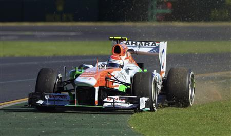 Force India Formula One driver Adrian Sutil of Germany runs off the track during the second practice session of the Australian F1 Grand Prix at the Albert Park circuit in Melbourne March 15, 2013. REUTERS/Scott Wensley