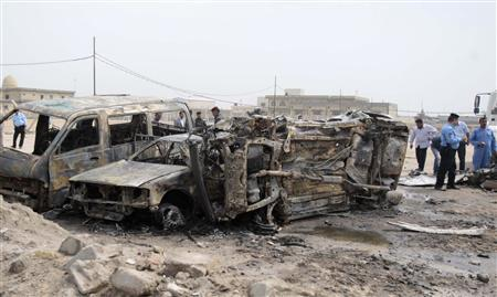 Police examine the wreckage after a car bomb exploded in Basra, 420 km (261 miles) southeast of Baghdad March 17, 2013. REUTERS/Atef Hassan