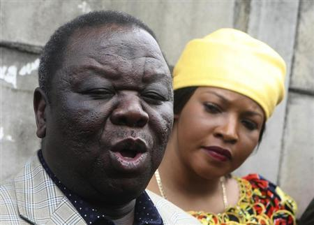 Zimbabwe's Prime Minister and President of the Movement for Democratic change (MDC) Morgan Tsvangirai (L) and his wife Elizabeth speak to the media after casting their votes in a referendum at a polling station in Harare March 16, 2013. REUTERS/Philimon Bulawayo