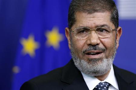 Egypt's President Mohamed Mursi answers reporters' questions after meeting European Commission President Jose Manuel Barroso (unseen) at the EU Commission headquarters in Brussels September 13, 2012. REUTERS/Francois Lenoir