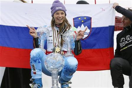 Slovenia's Tina Maze poses with her women's overall, Giant Slalom and Super-G World Cup trophies at the Alpine Skiing World Cup finals in Lenzerheide March 17, 2013. REUTERS/Pascal Lauener