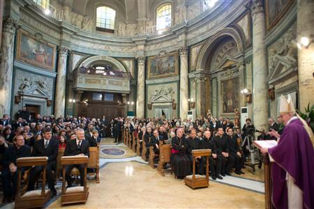 Pope Francis I (R) conducts a mass in Santa Anna church inside the Vatican, in a picture released by Osservatore Romano at the March 17, 2013. REUTERS/Osservatore Romano