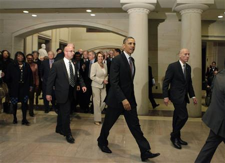 President Barack Obama (C) leaves after a meeting with the House Democratic Caucus on Capitol Hill in Washington March 14, 2013. REUTERS/Yuri Gripas