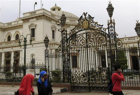 People walk in front of parliament in Cairo March 7, 2013. REUTERS/Mohamed Abd El Ghany