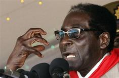 Zimbabwe's President Robert Mugabe gestures as he speaks during an event marking his 89th birthday at Chipadze stadium in Bindura, about 90 km (56 miles) north of the capital Harare March 2, 2013. REUTERS/Philimon Bulwayo