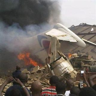 The wreckage of a plane burns in Nigeria's commercial capital Lagos, June 3, 2012. The source said the aircraft belonged to privately owned domestic carrier Dana Air. REUTERS/Stringer