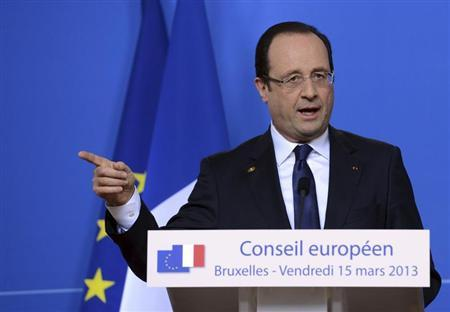 France's President Francois Hollande holds a news conference at the end of a European Union leaders summit in Brussels March 15, 2013. REUTERS/Laurent Dubrule