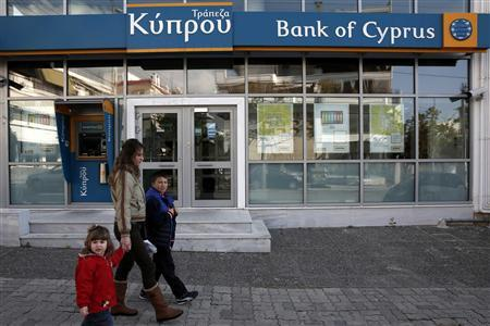 A woman with children walks past a branch of Bank of Cyprus at Glyfada suburb in Athens March 17, 2013. REUTERS/Yorgos Karahalis