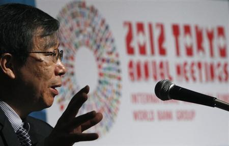 People's Bank of China Deputy Governor Yi Gang delivers a speech during a program of seminars at the Annual Meetings of the IMF and the World Bank Group in Tokyo October 14, 2012. REUTERS/Issei Kato