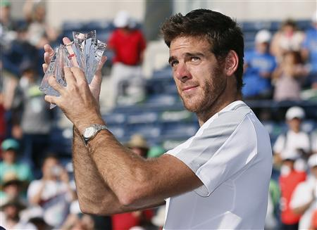 Juan Martin Del Potro of Argentina holds his runner's up trophy after losing to Rafael Nadal of Spain in the men's singles final match at the BNP Paribas Open ATP tennis tournament in Indian Wells, California, March 17, 2013. REUTERS/Danny Moloshok