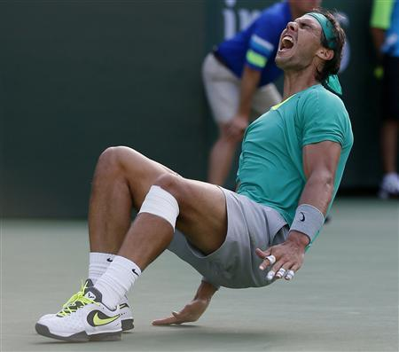 Rafael Nadal of Spain celebrates defeating Juan Martin Del Potro of Argentina in the men's singles final match to win the BNP Paribas Open ATP tennis tournament in Indian Wells, California, March 17, 2013. REUTERS/Danny Moloshok