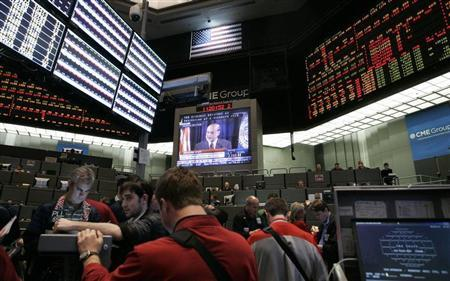 Traders at the CME Group watch a television broadcast of Federal Reserve Chairman Ben Bernanke as he answers questions during a first-ever news conference shortly after the Federal Open Market Committee's decision to leave short-term interest rates untouched between zero and 0.25 percent in Chicago April 27, 2011. REUTERS/Frank Polich