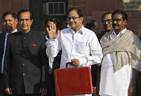 India's Finance Minister Palaniappan Chidambaram (C) poses as he leaves his office to present the 2013/14 federal budget in New Delhi February 28, 2013. REUTERS/B Mathur