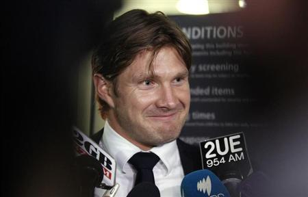 Suspended Australian cricket vice-captain Shane Watson smiles as he talks to the media after his arrival at the Sydney International Airport March 12, 2013. REUTERS/Daniel Munoz