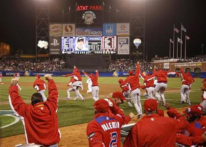 Puerto Rico players celebrate after defeating Japan in their semi-final World Baseball Classic game in San Francisco, California, March 17, 2013. REUTERS/Stephen Lam