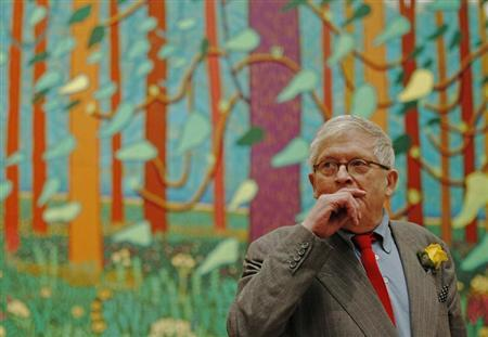 British artist David Hockney poses in front of a detail of his painting ''The Arrival of Spring in Woldgate, East Yorkshire in 2011 (twenty-eleven)'' at the Royal Academy of Arts in London January 16, 2012. REUTERS/Luke MacGregor
