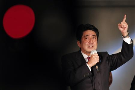 Japan's then main opposition Liberal Democratic Party's (LDP) leader and former Prime Minister Shinzo Abe speaks to voters atop a campaign van at Akihabara electronics store district in Tokyo, in this file picture taken December 15, 2012, on the last election campaign day ahead of the general election. Abe's first politically risky step of declaring the country's intent to join talks on a U.S.-led Pacific Rim free trade pact appears to be paying off as his record high ratings edge even higher. REUTERS/Yuriko Nakao/Files