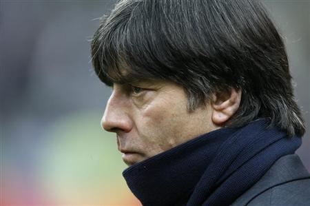 Germany's coach Joachim Loew watches his players warm up before their international friendly soccer match against France at the Stade de France stadium in Saint-Denis, near Paris, February 6, 2013. REUTERS/Charles Platiau