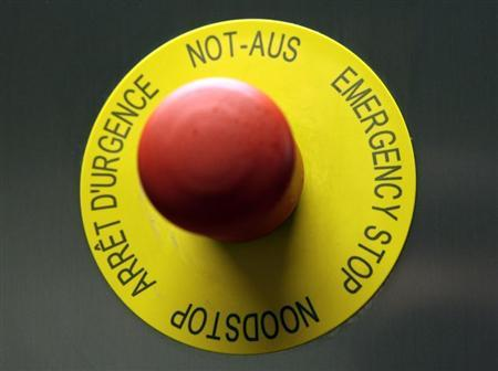 An emergency stop button is pictured in the P3 level research laboratory against tuberculosis at the School of Life Sciences of the Swiss Federal Institute of Technology (EPFL) in Ecublens near Lausanne March 17, 2010. REUTERS/Denis Balibouse