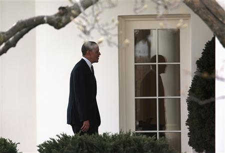 U.S. President Barack Obama walks to the Oval Office of the White House upon his return from Chicago to Washington March 15, 2013. REUTERS/Yuri Gripas