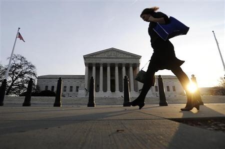 A pedestrian walks past the US Supreme Court building in Washington, December 8, 2009. REUTERS/Jonathan Ernst