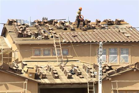 A worker lays shingles as construction continues on a residential home in Carlsbad, California September 19, 2011. REUTERS/Mike Blake