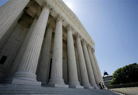People walk down the steps of the Supreme Court in Washington May 20, 2009. REUTERS/Molly Riley