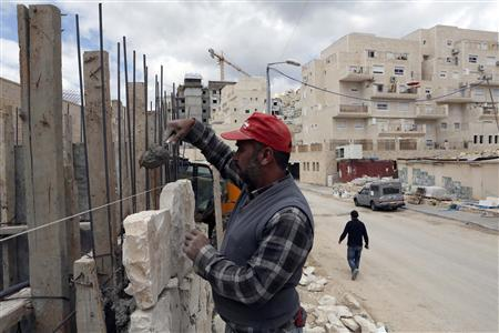 A Palestinian labourer works on a construction site in a Jewish settlement near Jerusalem known to Israelis as Har Homa, and to Palestinians as Jabal Abu Ghneim March 18, 2013. Israeli Prime Minister Benjamin Netanyahu's new governing coalition prepared to take office after a parliamentary vote on Monday with powerful roles reserved for supporters of settlers in occupied territory. REUTERS/Baz Ratner