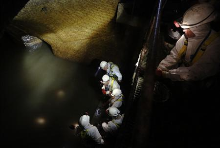 Members of the media are shown the Thames Water Fleet sewer, a Victorian sewer system designed by Joseph Bazalgette, beneath the streets of London March 13, 2013. REUTERS/Luke MacGregor