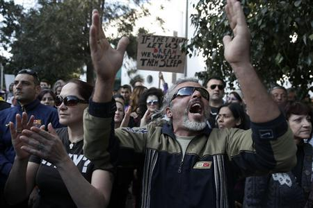 Protesters shout slogans during an anti-bailout rally outside the parliament in Nicosia March 18, 2013. REUTERS/Yorgos Karahalis