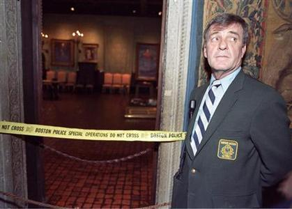 Security guard Paul Daley stands guard at the door of the Dutch Room of the Isabella Stewart Gardner Museum in Boston March 21, 1990. Reuters/Jim Bourg