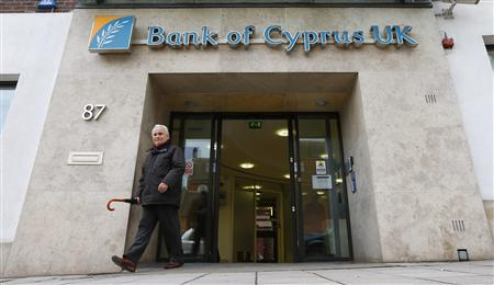 A customer walks out of a branch of Bank of Cyprus UK, in north London March 18, 2013. REUTERS/Andrew Winning