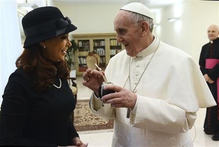 Newly elected Pope Francis, Cardinal Jorge Mario Bergoglio of Argentina, holds a mate given to him as a present from Argentine President Cristina Fernandez de Kirchner at the Vatican City in this handout picture provided by the Argentine Presidency March 18, 2013. REUTERS/Argentine Presidency/Handout