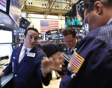 Traders work on the floor at the New York Stock Exchange, March 18, 2013. REUTERS/Brendan McDermid