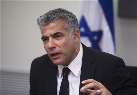 Yair Lapid (C), speaks during a Yesh Atid party meeting, at the Knesset, the Israeli parliament, in Jerusalem March 4, 2013. REUTERS/Ronen Zvulun