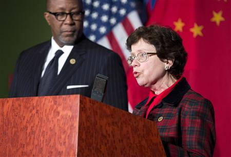 Acting Secretary of Commerce Rebecca Blank speaks as U.S. Trade Representative Ron Kirk listens at a news conference during the 23rd session of the U.S.-China Joint Commission on Commerce and Trade in Washington on December 19, 2012. REUTERS/Joshua Roberts