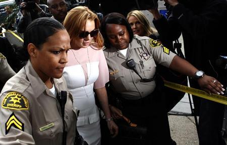 Actress Lindsay Lohan arrives for court at the Airport Branch of the Los Angeles Superior Courthouse in Los Angeles, California March 18, 2013. REUTERS/Patrick T. Fallon