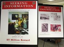 FBI posters displaying works by artists Johannes Vermeer and Edgar Degas are seen during a press conference held to appeal to the public for help in returning artwork stolen in 1990 from the Isabella Stewart Gardner Museum in Boston, Massachusetts March 18, 2013. REUTERS/Jessica Rinaldi