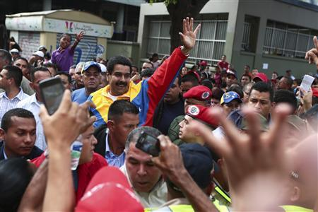 Venezuela's acting President Nicolas Maduro (C) greets supporters during a gathering in Caracas March 16, 2013 in this picture provided by the Miraflores Palace. REUTERS/Miraflores Palace/Handout