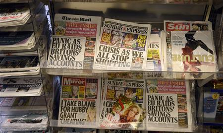 Newspapers are displayed for sale at a newsagents in central London March 17, 2013. REUTERS/Paul Hackett