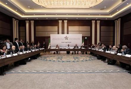 Syrian Opposition Coalition members and Syrian National Coalition members attend a meeting in Istanbul March 18, 2013. REUTERS/Osman Orsal