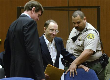 Defendant Christian Gerhartsreiter (C) from Germany arrives for the start of his murder trial at the Los Angeles Superior Court in Los Angeles March 18, 2013. REUTERS/Joe Klamar/Pool
