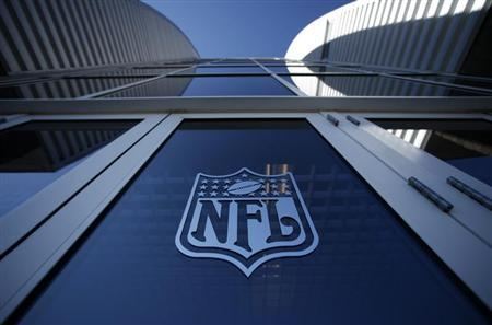 The NFL logo appears on an entrance door to the football stadium at Super Bowl XLII in Glendale, Arizona February 2, 2008. REUTERS/Mike Blake