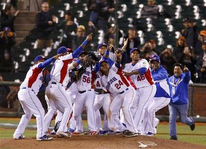 The Dominican Republic team celebrates after defeating the Netherlands during their semi-final World Baseball Classic game in San Francisco, California, March 18, 2013. REUTERS/Mike Blake