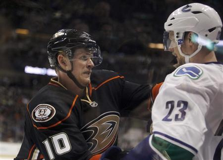 Anaheim Ducks right wing Corey Perry (10) attempts to incite Vancouver Canucks defenseman Alexander Edler (23) of Sweden into a fight, but Perry gets called for two penalties on the play, one for roughing and another for charging, during the second period of their NHL hockey game in Anaheim, California January 25, 2013. REUTERS/Alex Gallardo