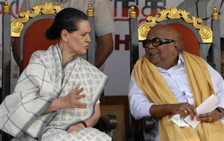 Chief of India's ruling Congress party Sonia Gandhi (L) speaks with M. Karunanidhi, chief minister of the southern Indian state of Tamil Nadu and leader of Dravida Munnetra Kazhagam (DMK) party, during an election campaign rally in Chennai April 5, 2011. REUTERS/Babu