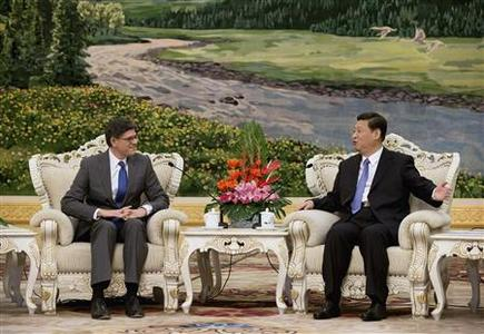 U.S. Treasury Secretary Jacob Lew (L) speaks with China's President Xi Jinping during their meeting at the Great Hall of the People in Beijing March 19, 2013. REUTERS/Andy Wong/Pool
