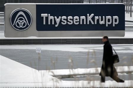 A man walks past a logo of Germany's industrial conglomerate ThyssenKrupp AGat their headquarters in Essen January 16, 2013. REUTERS/Ina Fassbender