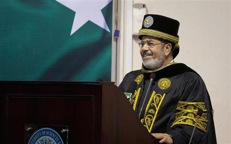 Egypt's President Mohamed Mursi speaks during a ceremony at the National University of Science and Technology (NUST) in Islamabad March 18, 2013. REUTERS/Mian Khursheed