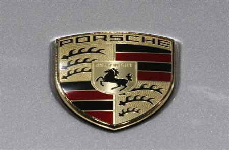 A Porsche logo is seen on a displayed car on media day at the Paris Mondial de l'Automobile September 27, 2012. REUTERS/Christian Hartmann